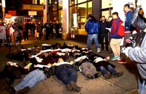 "Die-in by staff of the Center for Constitutional Rights, 12/17/14, part of a city-wide 7 minute collective ""Die-in/ Rise up"" action to mark the 5 month anniversary of the killing of Eric Garner"