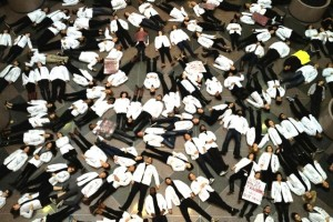 "Harvard medical students participate in nationwide ""White Coat Die-in"" 12/10/14"