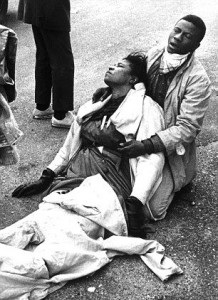 Boynton Robinson, severely injured on Bloody Sunday, cradled by a stranger.