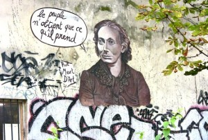 "Montmartre graffiti art. Rough translation, ""The people manage to obtain only that which they take."""